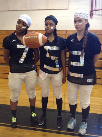 Volleyball players dress as football players to show school spirit