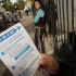 Neighbors of Dr. Craig Spencer received fliers on Thursday, in both English and Spanish, regarding the Ebola virus. Some neighbors gathered on Friday, Oct. 24, 2014, outside Dr. Spencer's Harlem building. (Carolyn Cole/Los Angeles Times/MCT)