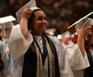Toni Akunebu moves her tassel from right to left.