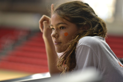 Olivia Hruby raises her finger to show that there is one point left in the game for Clemson to win.