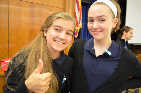 Olivia Rose Griesmer (9) and McClain D'Aoust (9) are excited about buying the teal ribbons to support ovarian cancer.