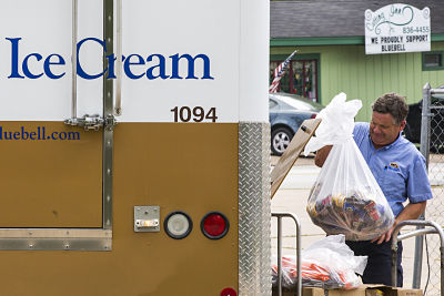A Blue Bell Creameries employee loads recalled ice cream into a truck after picking it up from a convenience store on Thursday, April 23, 2015, in Brenham, Texas. Blue Bell recalled all of its products earlier in the week after more ice cream samples tested positive for Listeria. (Smiley N. Pool/Dallas Morning News/TNS)