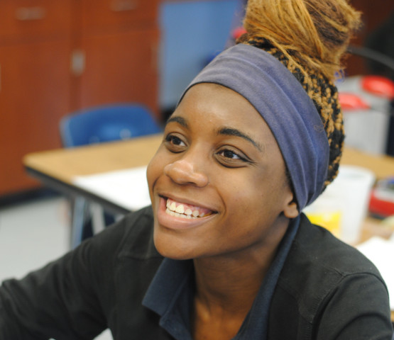Helen Onuorah (12) speaks with friends in Biology class. Onuorah is one of three ARS seniors to be named a Questbridge Finalist.
