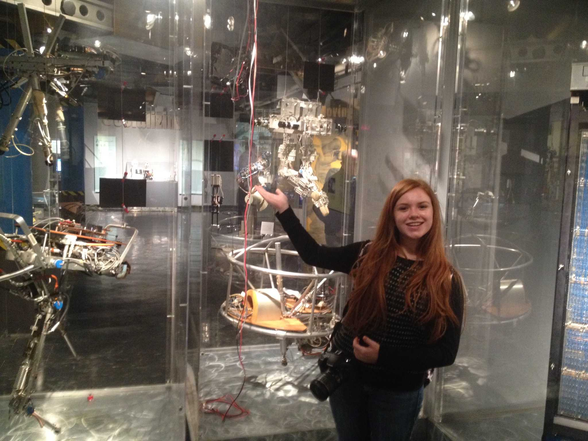 Katya Wittliff (12) smiles in front of space technology exhibit at a university nearby to Boston, where she spent a day shadowing a current student.