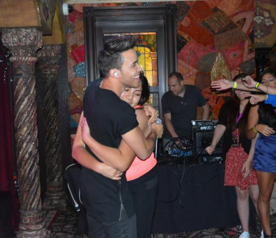 Esmeralda Juarez (12) hugs Latin pop singer, Prince Royce, at a private meet and greet hosted by a radio station, September 18th, 2015. Juarez has met Royce the most times in Houston.