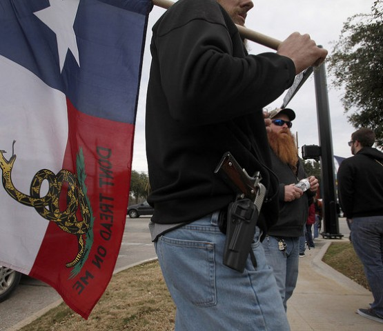 Benjamin Ralston with his Kimber Pro Carry 1911, front, joins other activists during an Open Carry Walk in Arlington, Texas, on Friday, Jan. 1, 2016. (Brad Loper/Fort Worth Star-Telegram/TNS)