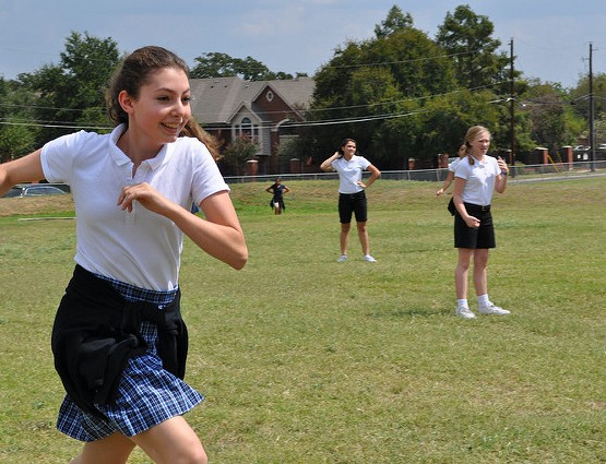 Middle schoolers run around during Fitness Friday.