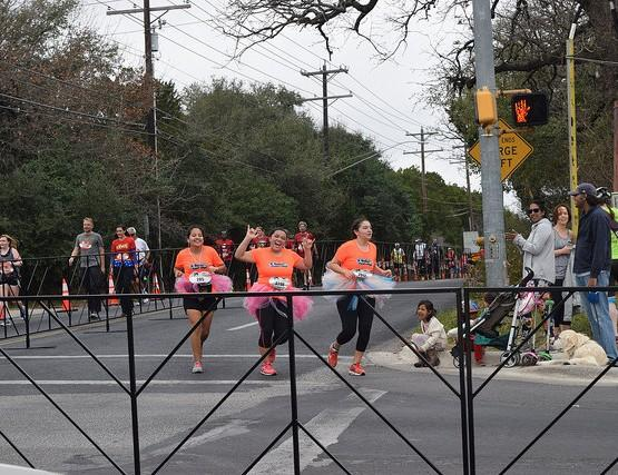 Katy Pacheco (12), Anabel Martinez (10), and Brenda Puente (9) reach the 10 mile mark on their way to completing the full marathon. Photo by Emma Foster