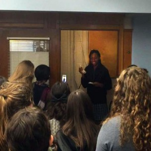 Maya Nunez giving her senior speech over the intercom, supported by her fellow seniors. Photo taken by Erin Lungwitz.