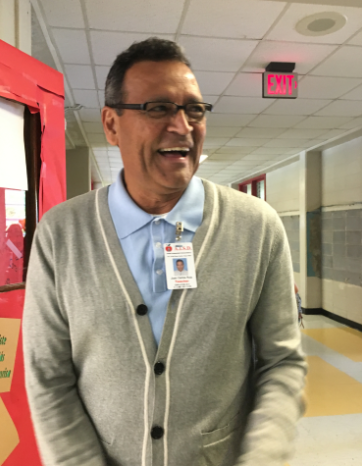 """Spanish teacher Juan Carlos Ruiz welcomes students into class. Ruiz plans to show students the movie """"The Perfect Game"""" to connect baseball and  latin athletes struggles  in the late 50's."""