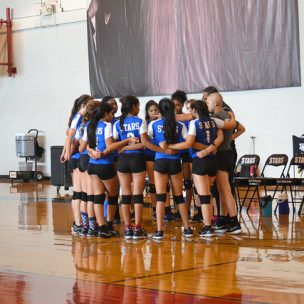 The freshman volleyball team huddle up before a home game against Pflugerville on August 30th in the big gym.