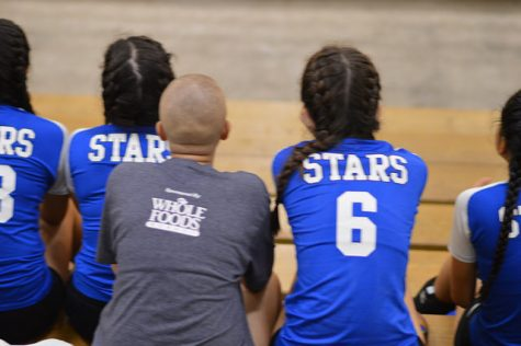 The freshman team watches on during a volleyball tournament at Bowie as they wait for their turn to play.