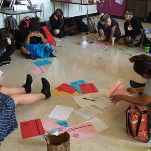 High-school GSA members make posters for ally week in GSA club after a group discussion. Photo by Ezra Morales.