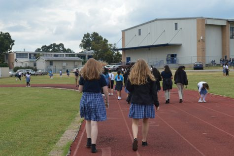 Ann Richards walk around the track during Friday fitness to help relieve stress. Photo was taken by Ahna Stewart (9).