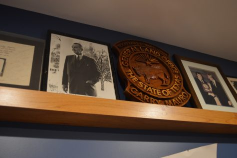 A shelf in Mauro's office holds a plaque commending his work as Texas Land Commissioner. Photo by Ally Wait.
