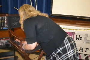 Ally signing the author chair