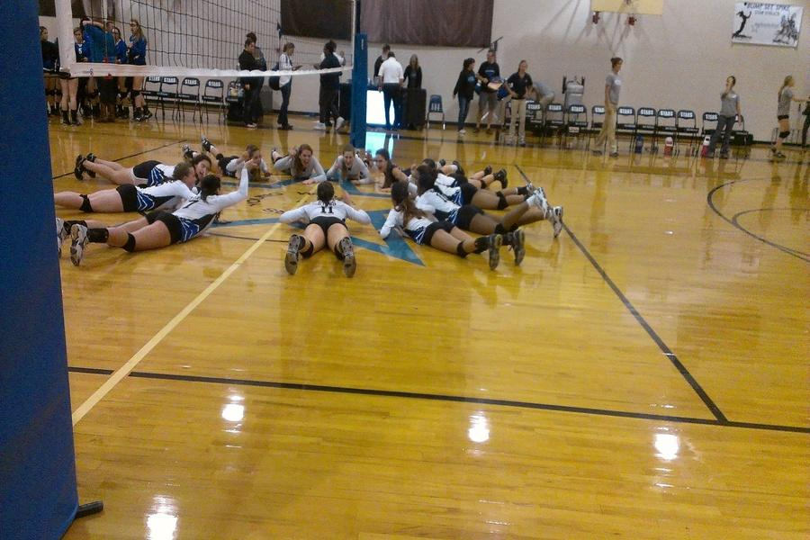 The Stars Varsity team meets in the middle to celebrate their big victory