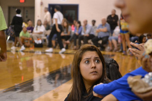 Ava Martinez (Grade 9) looks panicked as the JV game goes on in suspense