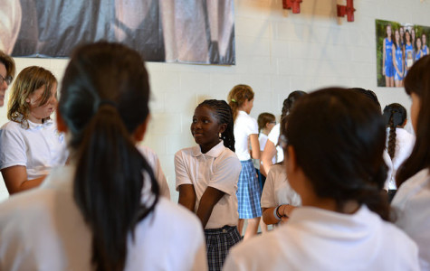 Sixth grader Keji Jerkins plays a name game with new classmates Tuesday, Ausgust 26. It was her second day of middle school.
