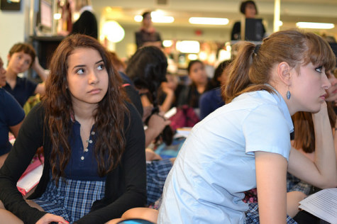 Juniors Alex Migl (left) and Gabrielle Redden (right) listen as Waugh explains the policy. Photo by Meredith Oldham