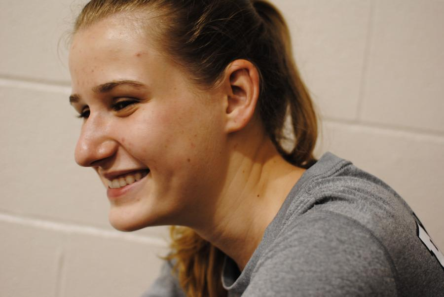 All Reznicek (11), varsity hitter, laughs before playing her cousin at the Bastrop Game on Friday Night.