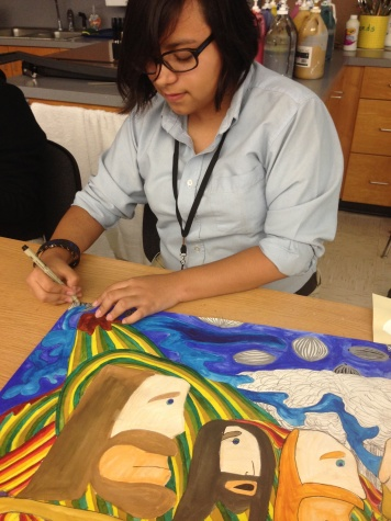 Salazar works on her art project. The Batman comics have influenced her artwork over the years.