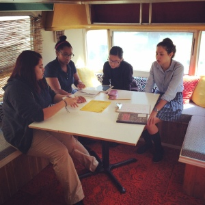 Chloe Coronado-Winn (12), Trinh Ha (12), Toni Akunebu (12), and Angelic Almaraz (12) brainstorm ideas for their project. Over the course of the year, they will design and develop a healthcare product.