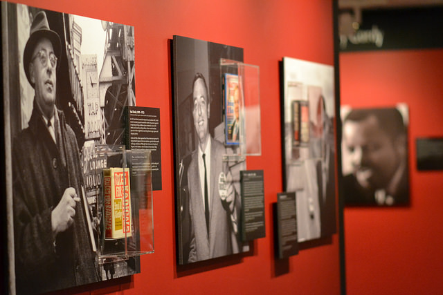 Photographs of prominent people line the walls of the 60s exhibit at the LBJ Library