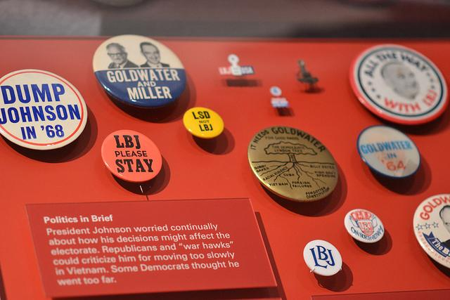Students observed buttons and other artifacts during their trip to the LBJ Presidential Library