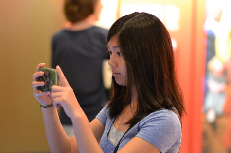 Alexandra Triampol (11) takes a photo of an artifact at the LBJ Presidential Library this past Sunday