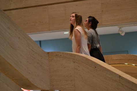 Students walk up the LBJ Library staircase to view the upstairs exhibits.
