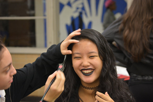 8th graders put the finishing touches on the perfect goth look for opposite day.