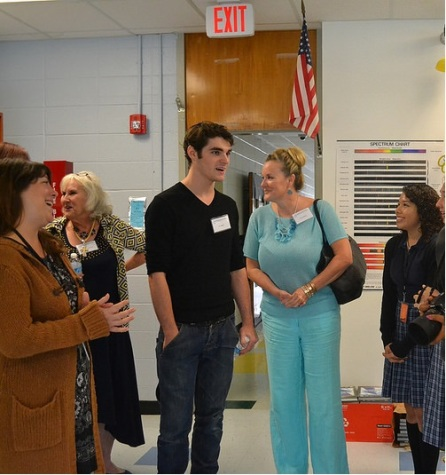 RJ Mitte and other board  members of theMitte Foundation take a tour of the Ann Richards School.