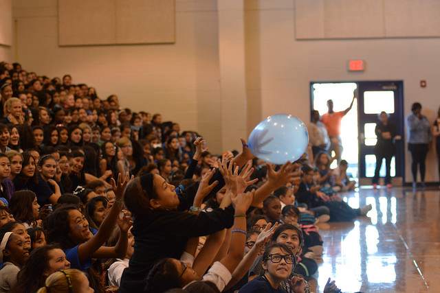 Sixth graders reach for a balloon during Friday's homecoming pep rally. This was the last day of homecoming festivities .