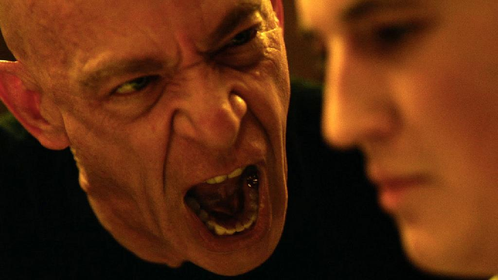 J.K. Simmons and Miles Teller during the movie Whiplash.