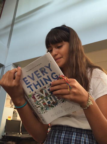 Frida Capitan (7) reads Everything, Everything by Nicola Yoon, a book she's reading in preparation for the festival on Saturday.