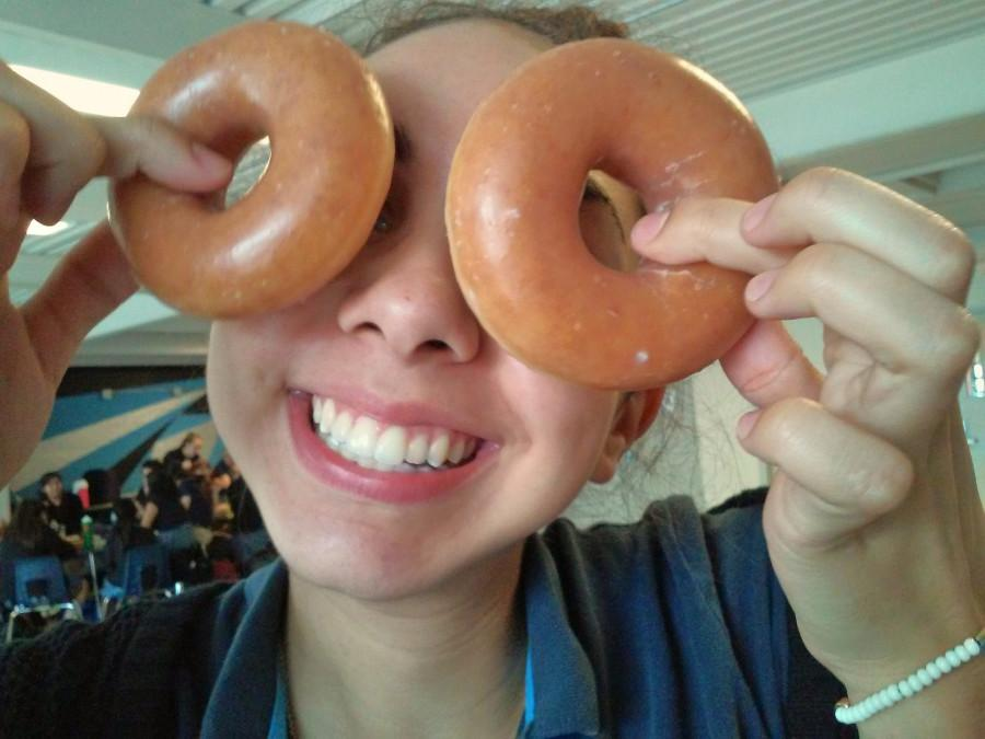 Olivia Crouch uses donuts from the