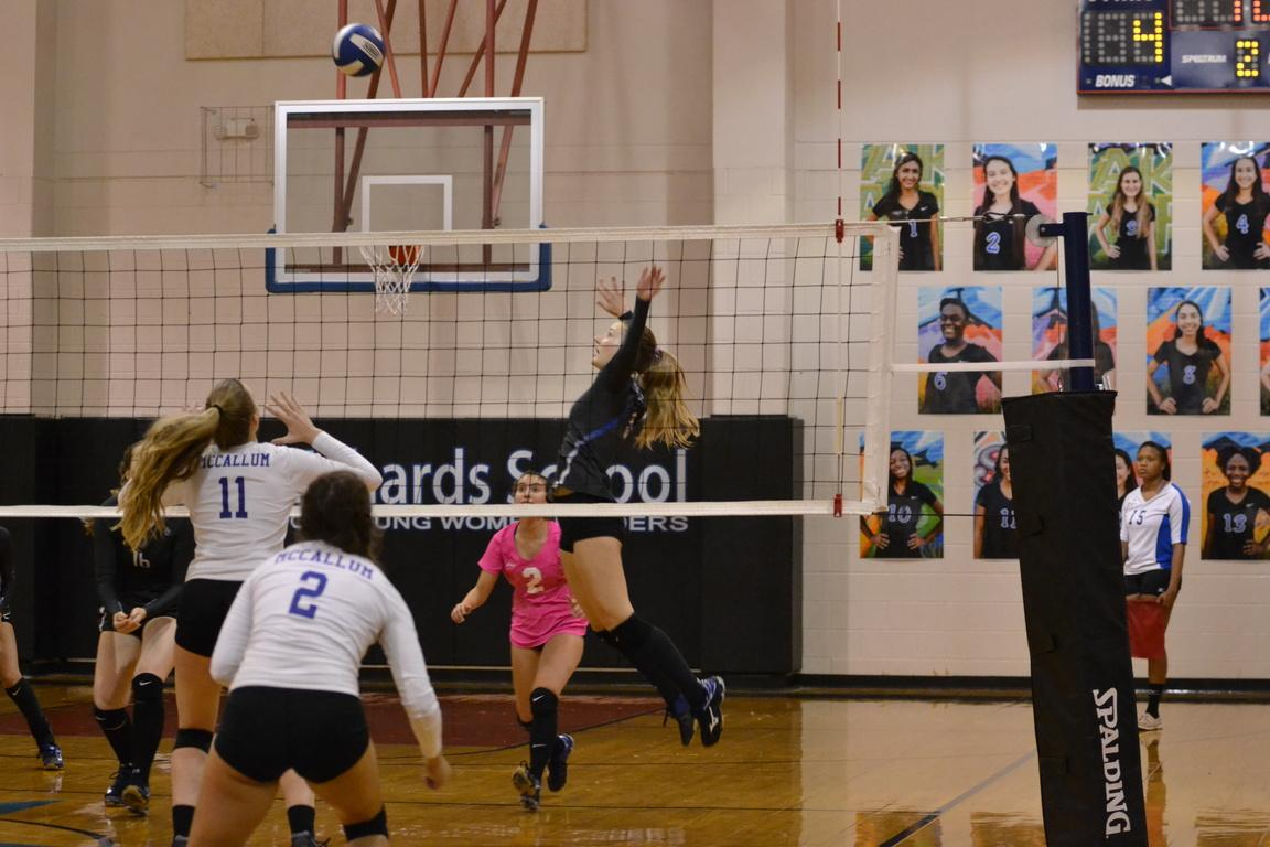 Ally Reznicek jumps to spike the ball to make a point. The ARS Varsity volleyball team has been district champs for the past two years, the Knights being one of three in the run for the title.