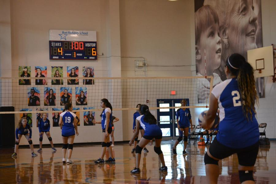 Seventh Grade B team volleyball player gets ready to serve the ball.