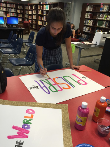 Wendy Rodriguez (11) designs posters to promote the Pulsera Project.
