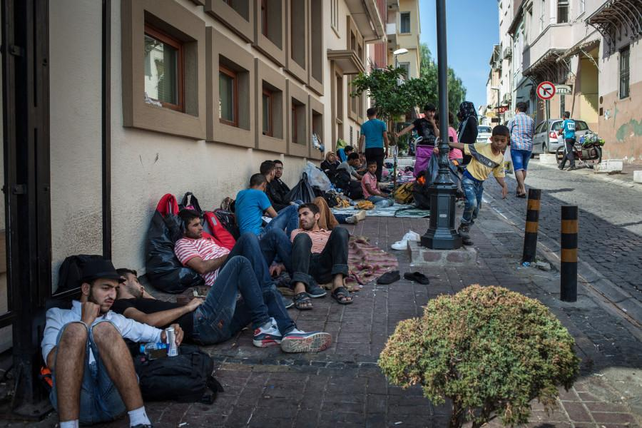 Syrians+sit+on+a+sidewalk+where+they+have+been+sleeping+in+Izmir%2C+Turkey%2C+while+they+wait+to+attempt+reaching+Greece+by+boat+on+Sept.+3%2C+2015.+This+year%2C+some+220%2C000+war+refugees+and+economic+migrants+have+arrived+in+Greece+from+Turkey+and+other+Mediterranean+jumping+off+points%2C+according+to+U.N.+figures.+%28Alice+Martins%2FMcClatchy%2FTNS%29
