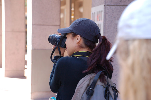 Yadira Iglesias (10) takes a photograph. Iglesias competed in the On Site Photography Competition in which students were given an allotted amount of time to take pictures around San Antonio that fit five themes: Urban, Pairs, Natural World, Inspiration and Culture. Photo taken by Lauren Breach.