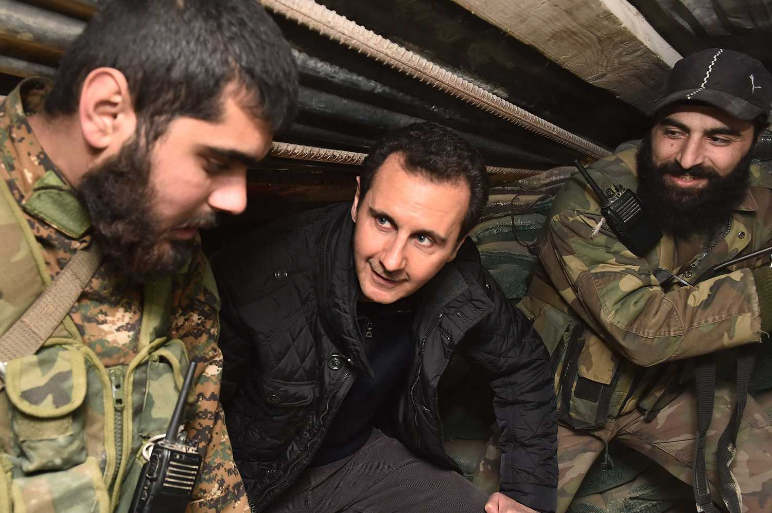 Syrian president Bashar Al Assad visits soldiers and officers at a military checkpoint near the area of Jobar, outskirts of Damascus, Syria, on December 31st, 2014. Assad has outlasted the Obama administration's 2011 prediction that his days are numbered. (Abaca Press/TNS)