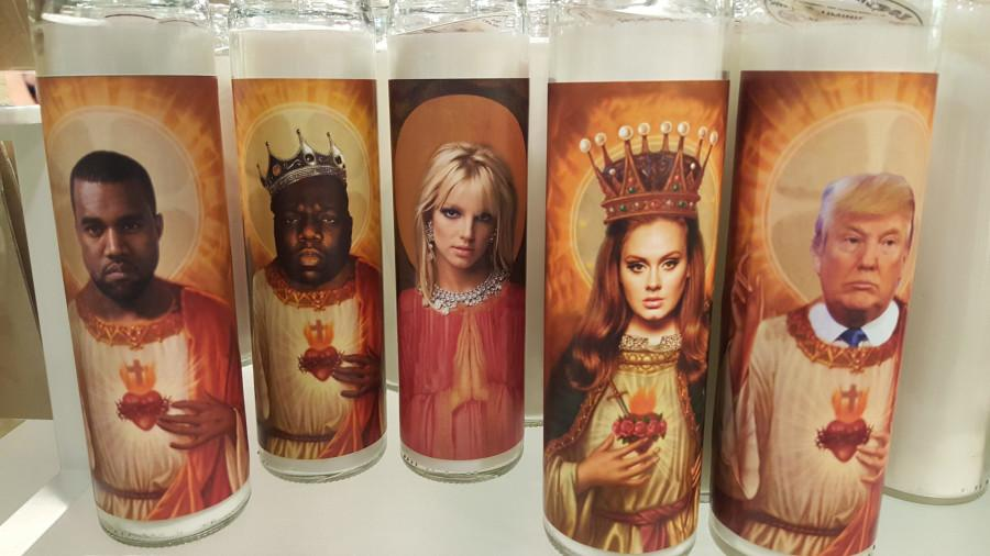 Candles with celebrities faces replacing the well known picture of Jesus or the Virgin Mary created by an artist.
