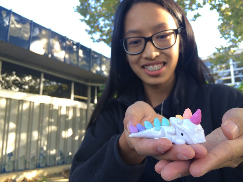 """Izzy Vergara holds one of her more complex polymer clay creations. She usually names the projects of hers that take longer to make. """"When I was younger, I named my stuffed cheetah Spot,"""