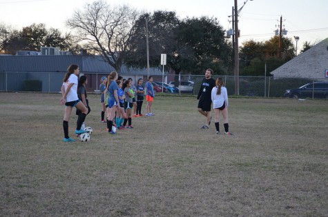 """Ortmann explains strategies and positions. Ortmann's team mantra is """"Get Better!"""" Photo by Sammie Seamon"""