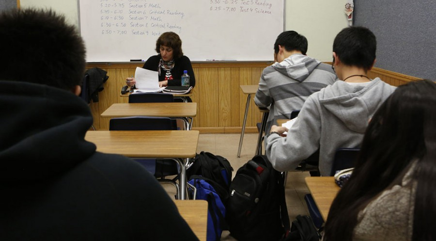 Teacher Svetlana Djananova monitors students as they take an ACT test in preparation for the college admission exam at HS2 Academy in Arcadia, Calif. (Anne Cusack/Los Angeles Times/TNS)