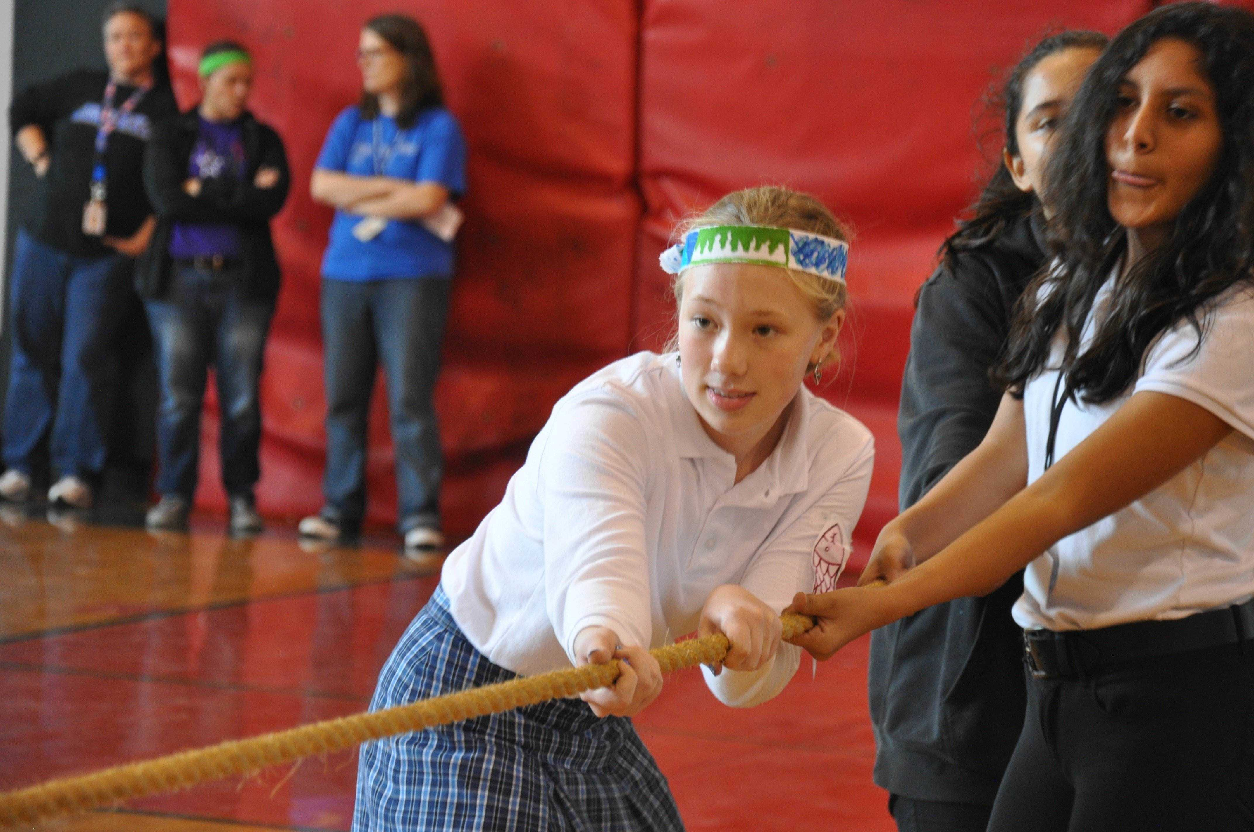 Aidan Trulove (8) pulls on the tug of war rope determining whether Pamela Mathai or Ella Miesner's advisory would win first place in Sisterlympics.