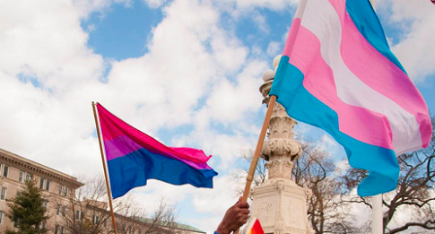 Bisexual and transgender flags being flown during rally for marriage equality on the steps of the US Supreme Court in Washington DC. Photo by Melissa Kleckner