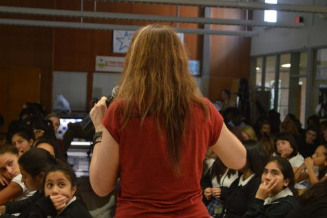 "Laurie Halse Anderson addresses the crowd in the cafeteria. Students and staff from across all grade levels attended this Q&A session, many having read Anderson's ""Speak"" in 8th grade."